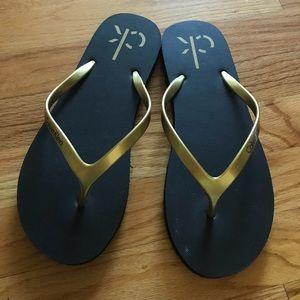 Calvin Klein Gold / Black Flip Flops NWOT
